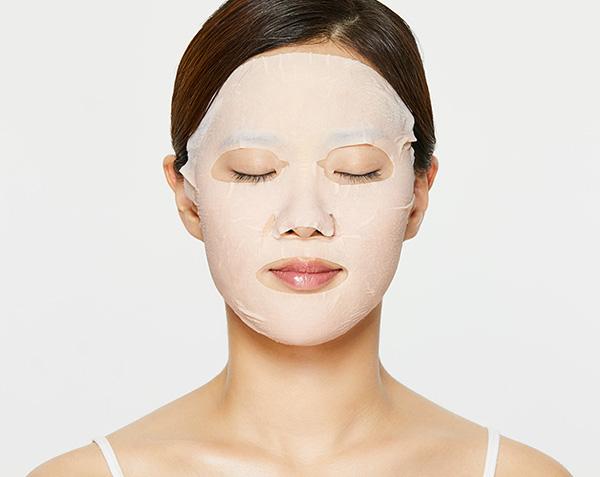 COSRX Holy Moly Snail Mask bőrtápláló fátyolmaszk csigamucinnal és ginzenggel